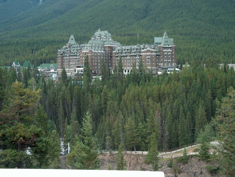 banff-springs-hotel-in-the-trees-in-banff-national-park-alberta-canada
